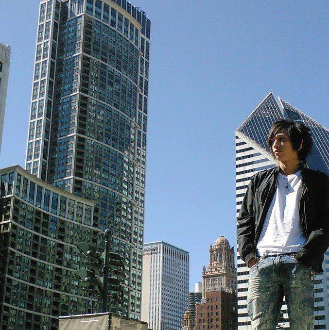 Jorge Martinez with the Chicago skyline.